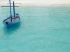 Typical Maldivian boat on blue ocean
