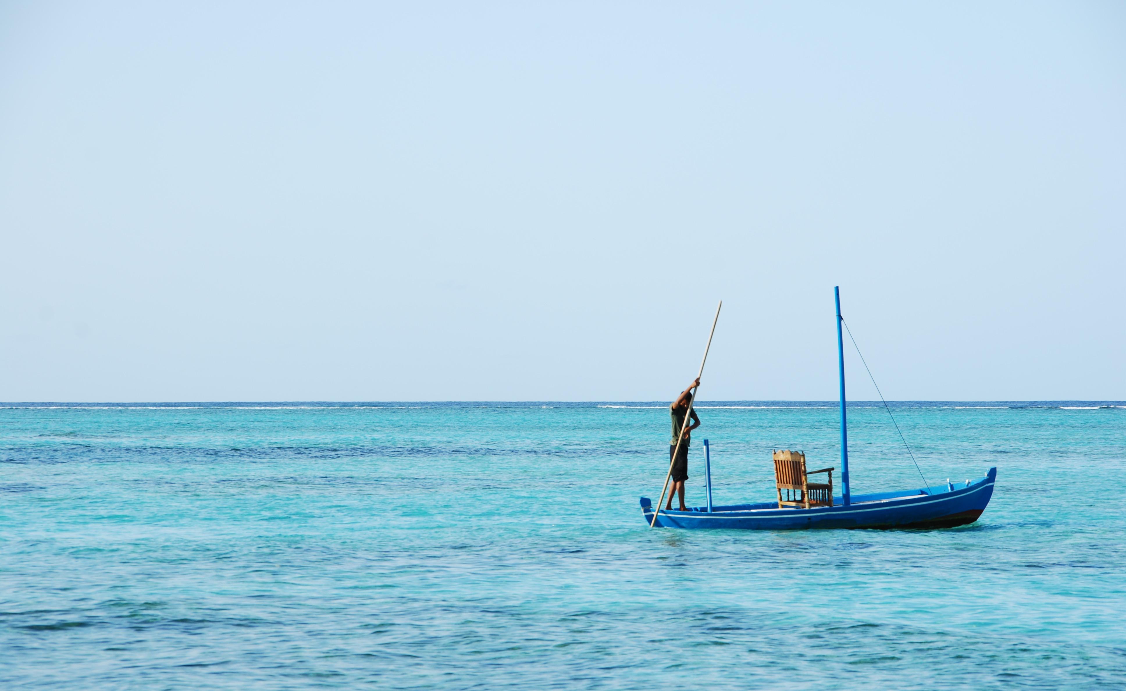 Typical Maldivian boat on blue ocean